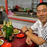 四輪タクシーの手配師のおじさんに餃子大王で再会@木蘭